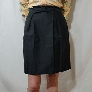Tibi black pleated mini skirt with bow in front